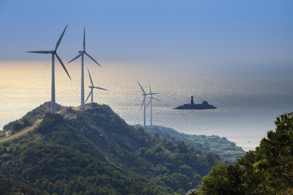 wind farm at the beach with beautiful seascape,green energy background