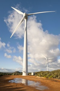 Wide angle image taken from in front of a large turbine on a rural wind farm.