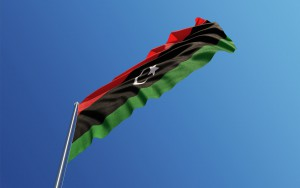 High quality 3d render of a Libyan Flag waving with wind on a blue sky. Low angle view with copy space. Clipping path is included. Great use for Libyan politics and Libyan culture related concepts. Horizontal composition.