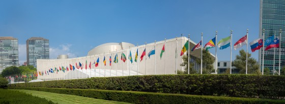 New York City, NY, USA - September 1, 2015: UN United Nations general assembly building with world flags flying in front